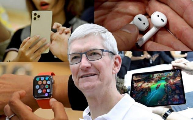 iPhoneの復調でハードウエア部門全体の売上高が8%伸びた(中央はティム・クックCEO)=ロイター
