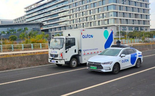 オートXのシステムを搭載した東風汽車の電気トラックとBYDの無人タクシー(同)