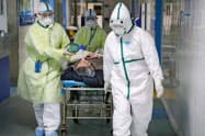 米中ビジネス評議会は新型肺炎支援でマスクなど医療品を寄付する(中国・武漢の病院)=ロイター