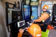 KDDIは大林組、NECと共同で5Gを活用した実証実験を実施。リアルタイムで建設機械を遠隔操作できる