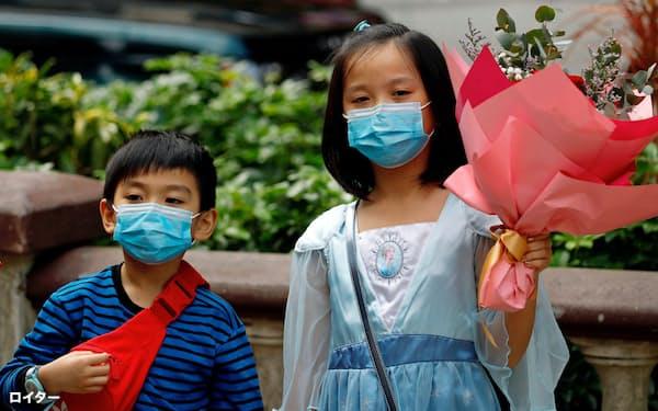 香港内で新型肺炎の感染が広がっている(14日)=ロイター