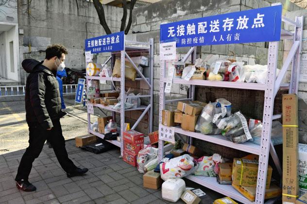 中国では厳戒態勢が続く(23日、北京市)=共同