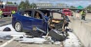 米当局はテスラ車の死亡事故について運転支援システムの不備を一因に挙げた=AP