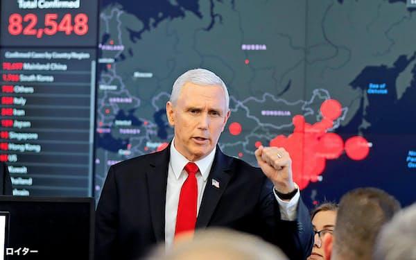27日、コロナウイルス対策会議のため、厚生省を訪れたペンス米副大統領=ロイター