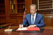 ムヒディン新首相は2日、官邸で首相としての執務を開始した=マレーシア政府提供