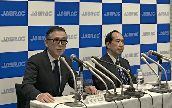 判決後に記者会見するJASRACの世古和博常務理事と、田中豊弁護士(2月28日、都内)