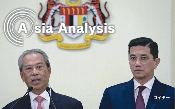 与党連合を離反し、野党と手を結んだムヒディン氏(左)は首相に、アズミン氏は貿易産業相の座に就いた(3月11日、マレーシアのプトラジャヤ)=ロイター