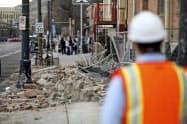 地震に見舞われたソルトレークシティーでは停電やビルの外壁が崩れるなどの被害が出ている(18日、ユタ州)=AP