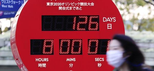 五輪開幕日は刻々と迫る(3月20日、東京都港区)