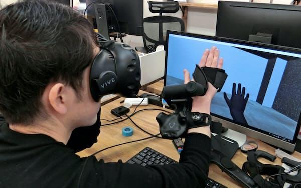 イクシーはVR内の物体の触感がわかるグローブ端末を開発した