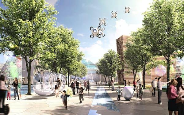 会場イメージには自動運転車両や上空を飛ぶ飛行物体が描かれている(経済産業省提供)