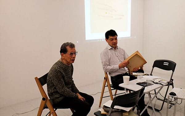 文化庁は戦後のギャラリーの調査を進めており、南画廊に勤めていた浅川邦夫氏(左)から聞き取りを行った