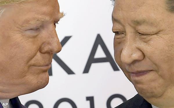トランプ米大統領と中国の習近平国家主席(2019年6月29日、大阪市)=AP