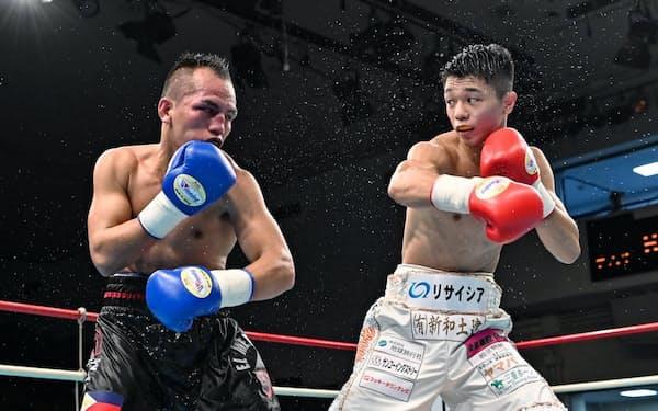 直近の試合では元世界王者メリンド(フィリピン、左)に6回TKO勝ち(2019年10月)
