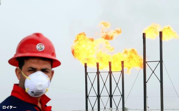 20年の世界石油需要は過去最大の減少幅となる見通し(イラクの油田施設)=ロイター