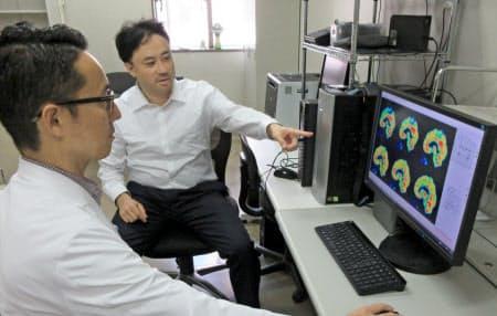 患者の脳をPETで調べる(横浜市立大学高橋琢哉教授提供)