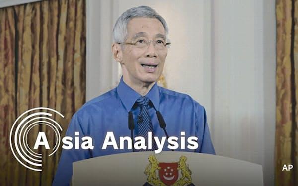 予期せぬ感染爆発で、シンガポールは「都市封鎖」を6月1日まで延長した(4月21日、国民向けに演説するリー・シェンロン首相)=AP(シンガポール情報通信省提供)