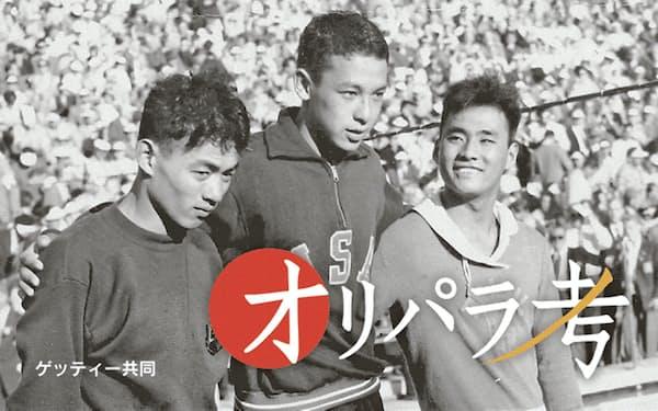 1952年ヘルシンキ五輪、競泳男子1500メートル自由形で銀メダルを獲得した橋爪(手前)