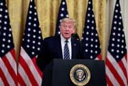 トランプ大統領は中国への報復措置に言及した(30日、ホワイトハウス)=ロイター