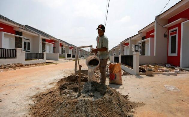 手ごろな住宅は持続可能なインフラのひとつで、社会経済的な効果がすぐに見込める=ロイター