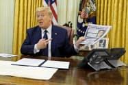 トランプ大統領は中国への対応措置を29日に発表すると明らかにした=AP