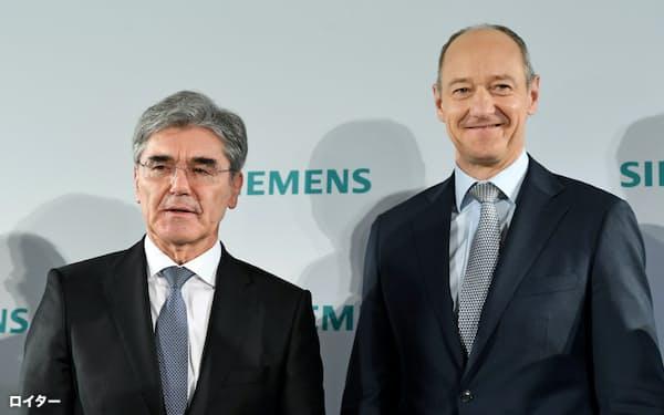 シーメンスを2013年から率いたケーザー社長(左)と次期社長に決まったブッシュ氏=ロイター