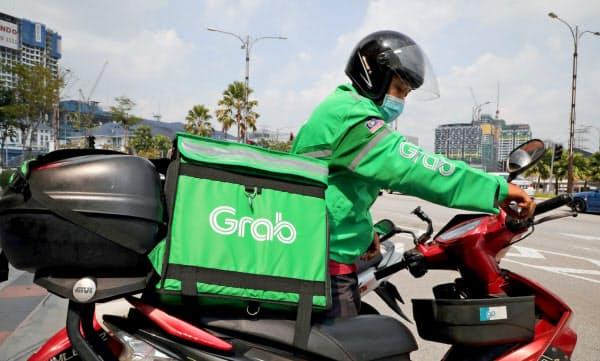 配車サービス大手のグラブ(シンガポール)も6月、全社員の約5%に相当する360人の解雇を発表した=ロイター