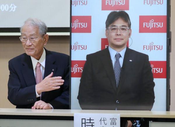 スパコン「富岳」がランキング世界一となり、記者会見する理研の松本理事長(左)とモニターに映し出された富士通の時田社長(右)(23日午前、神戸市中央区)