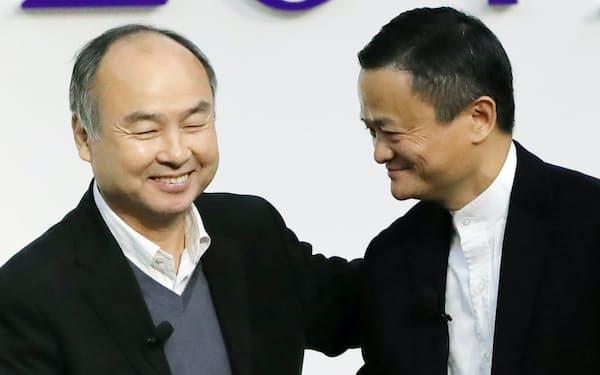 孫氏はスマホ決済アプリ事業で、中国アリババのアリペイを意識しているとみられる(右はアリババ創業者のジャック・マー氏)
