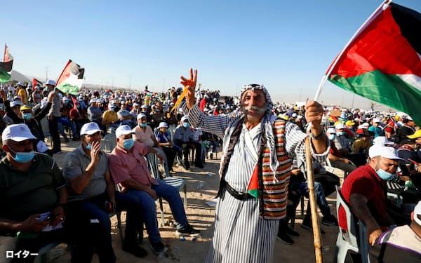 併合に反対する抗議集会(22日、パレスチナ自治区エリコ)=ロイター