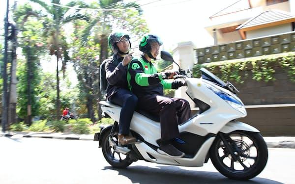 三菱商事はインドネシアの配車大手ゴジェックに出資し、モビリティーサービス強化に向けて布石を打つ