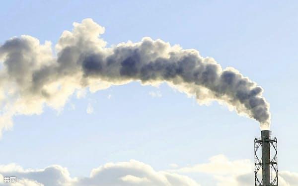 首相は温暖化ガス排出を50年に実質ゼロにする目標を主導する=共同