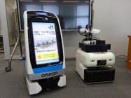 高輪ゲートウェイ駅で実証実験する搬送ロボット(左)と消毒作業ロボット