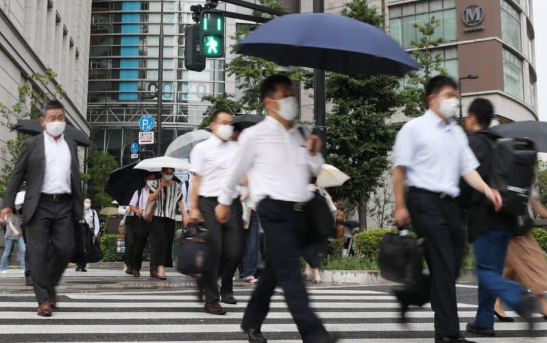 都内感染増、対応悩む企業 出社や会食制限も