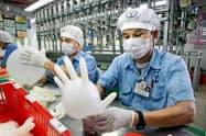 トップ・グローブにとって、外国人労働者の処遇改善が急務になっている(同社提供)