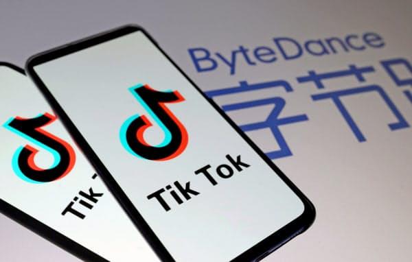 動画アプリTik Tok と運営するバイトダンスのロゴ=ロイター