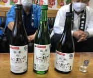 山形の方言「うまいもの」にちなんだ統一ラベルを貼った日本酒