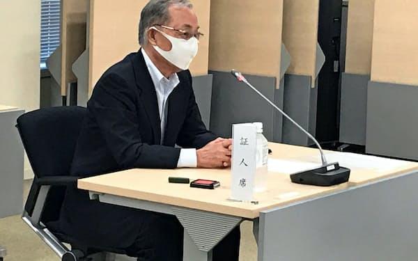 千代田区議会の百条委で証人尋問に臨む石川雅己区長(6月)