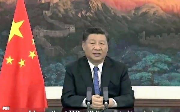 中国の習近平国家主席は28日のビデオ演説でAIIBは全加盟国の発展を促す新たな基盤になるべきだと強調した=共同
