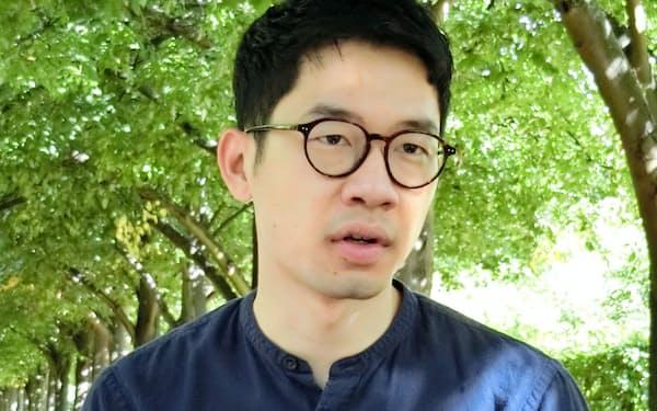 羅冠聡氏は英国から香港の民主化運動を続ける意向を示している(4日、ロンドン市内)