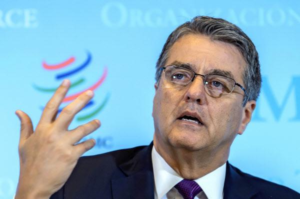 任期途中で退任するWTO事務局長のアゼベド氏は米ペプシコの幹部に転身する=AP