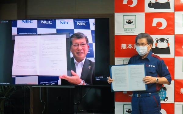 熊本県とNECは顔認証技術を使った観光支援システムの試験導入で連携協定を結んだ(熊本市)