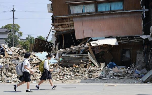 7月の九州豪雨では多くの家屋が被災した(熊本県人吉市)=共同