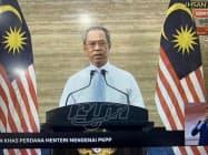 ムヒディン首相は28日、12月末まで軽度の活動制限を続ける意向を表明した