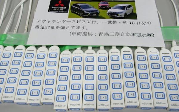 停電を想定して避難所の駐車場に置いた自動車から電源を供給(青森県今別町のいまべつ総合体育館)