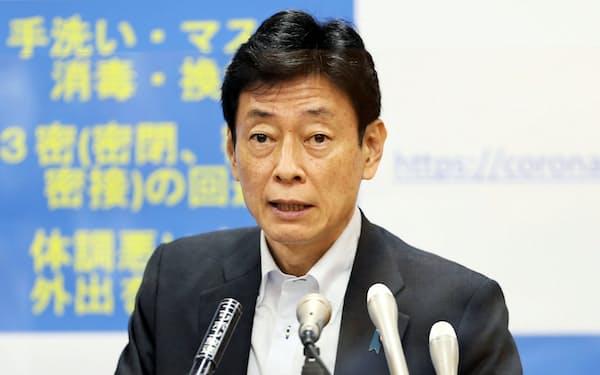 コロナ担当を兼務した西村康稔氏は感染防止と経済再開の両立路線を探った