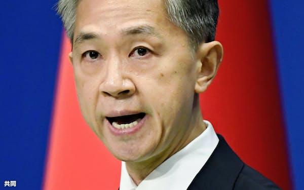 記者会見する中国外務省の汪文斌副報道局長=9月14日、北京(共同)