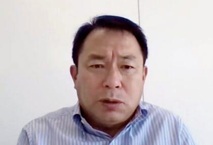 オンラインで取材に応じる日本サッカー協会の反町技術委員長(11日)=共同