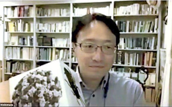 オンラインで開かれた「イグ・ノーベル賞」の授賞式に登場した京都大霊長類研究所の西村剛准教授(17日)=共同