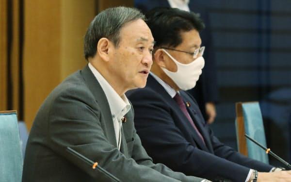 デジタル改革関係閣僚会議の初会合であいさつする菅首相(23日午前、首相官邸)